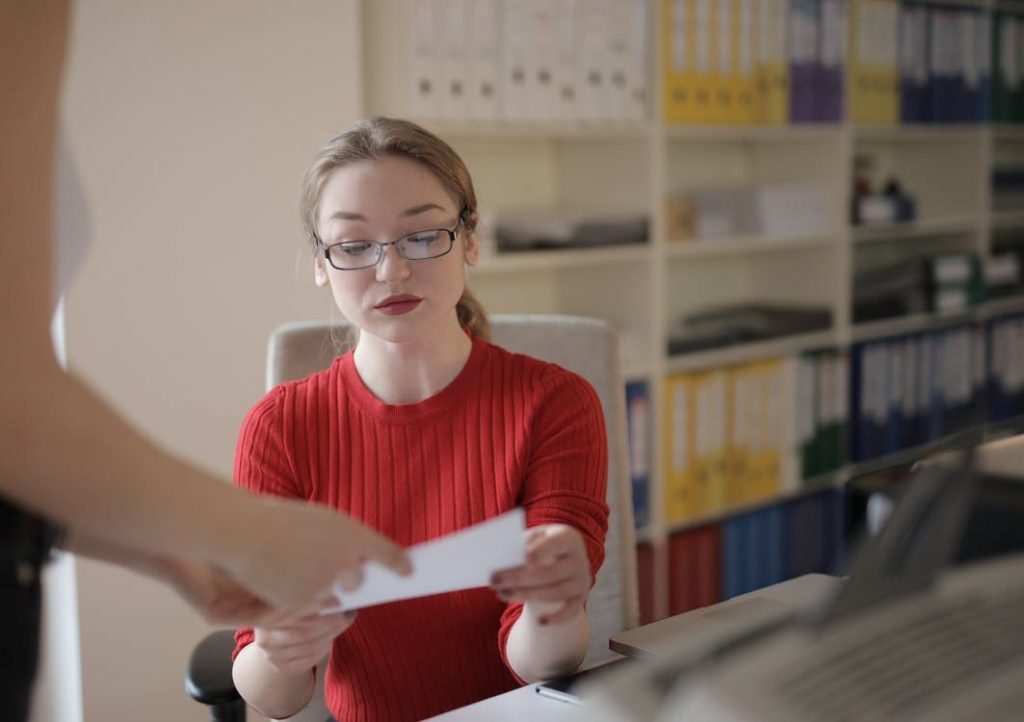 A bookkeeper examining financial documents