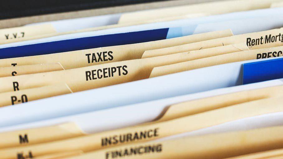 Tax folder in a file cabinet.