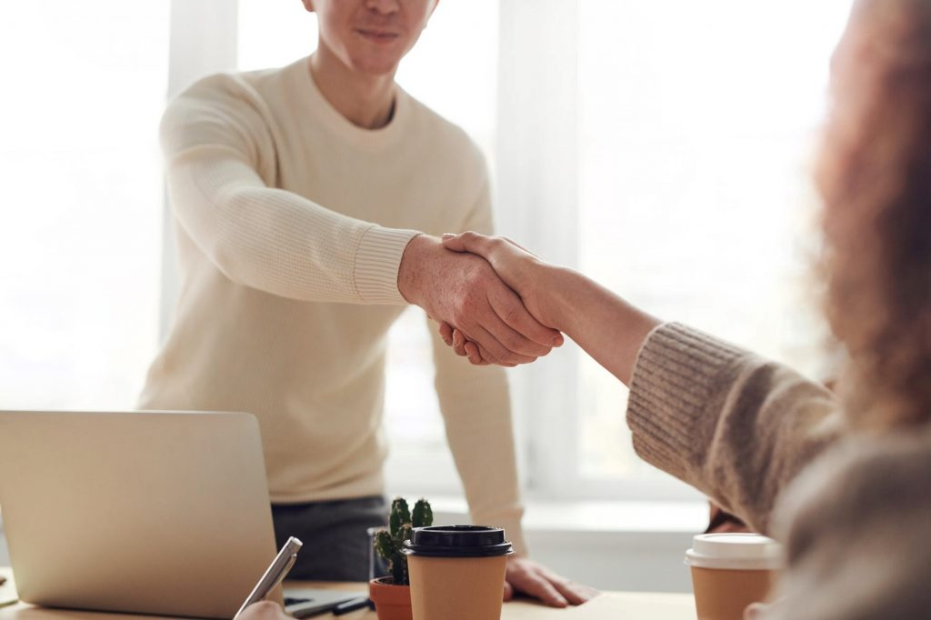 Company representative shaking hands with a client