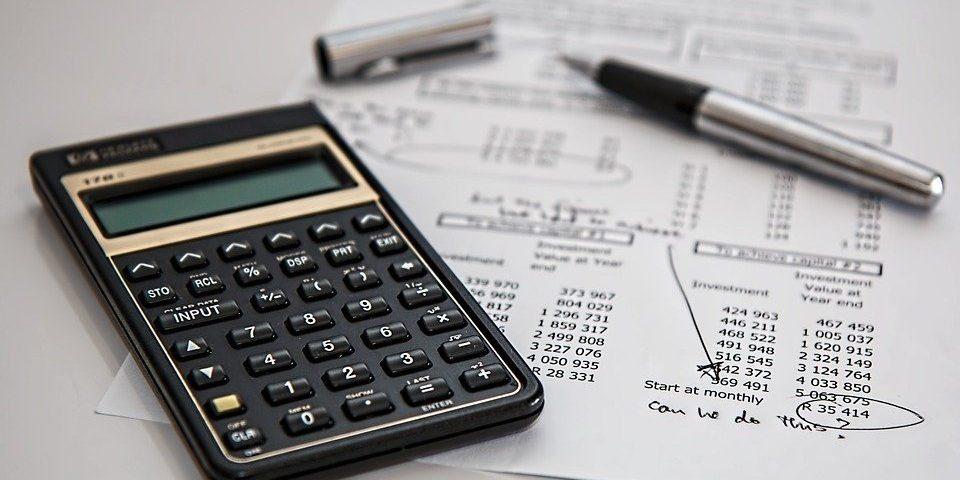 A black calculator placed near a balance sheet
