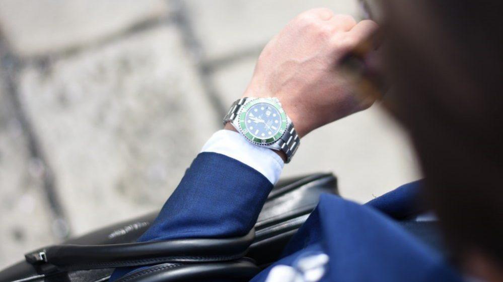 Man looking at his wristwatch